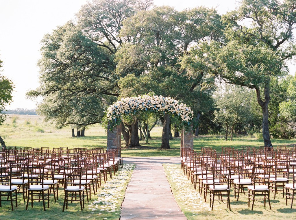 Outdoor Ceremony Site at Ma Maison set with Fruitwood Chiavari Chairs